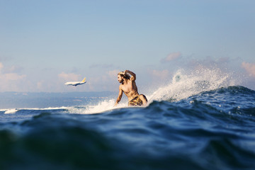 Mid adult man surfing in sea