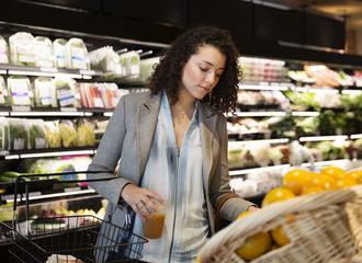 Businesswoman shopping at supermarket