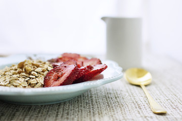 Strawberries and oats in plate on table