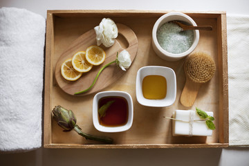 Overhead view of spa products in wooden tray