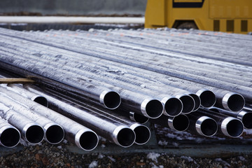 Close-up of metallic pipes at industry
