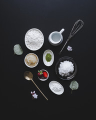 Overhead view of ingredients with kitchen utensils on table