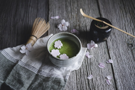 High angle view of Macha tea with marshmallows on wooden table