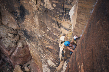 High angle view of hiker climbing mountains at Red Rock Canyon National Conservation Area