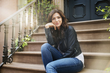 Portrait of beautiful woman sitting on steps
