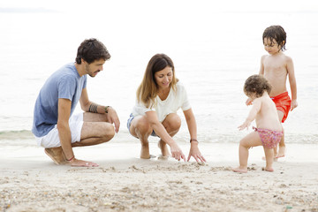 A happy family playing on the beach