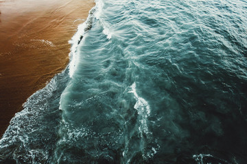 Overhead view of waves on sea shore