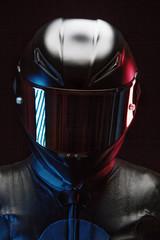 Close-up of biker wearing crash helmet