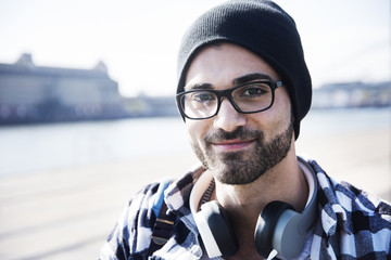Close-up portrait of smiling man with headphone