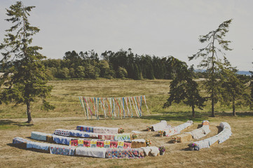 Clothes drying on stones on field against sky
