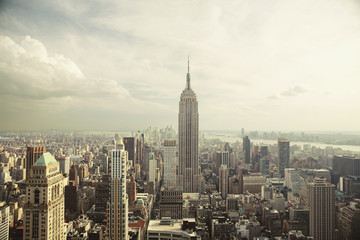 Empire State Building amidst cityscape against sky