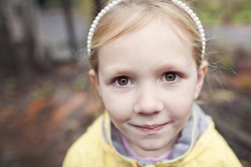 Portrait of cute girl standing in backyard