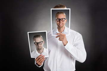 Man Holding Happy Picture In Front Of His Face