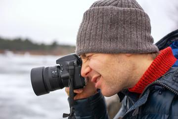 Closeup of photographer with digital camera outdoors. Beautiful