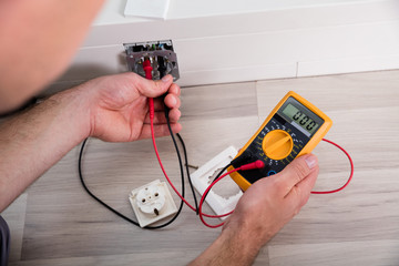 Person's Hand Holding Multimeter