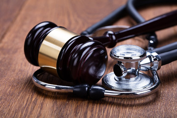 Close-up Of Gavel With Medical Stethoscope