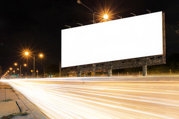 light trails, street and country in the night with blank billboard for advertising, display product or news