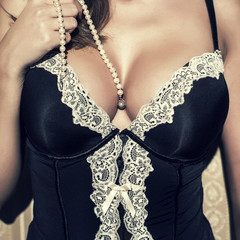 Sexy woman with big tits and pearls vintage