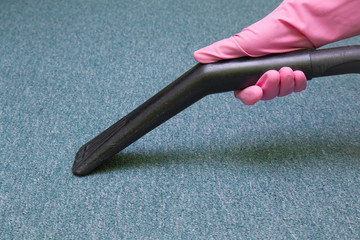 Professional vacuum cleaner nozzle frees the carpet from dust. Early spring cleaning or regular clean up.