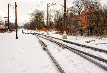 railway receding into the distance in the winter