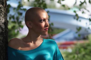 Young cancer survivor enjoying sunlight in spring nature