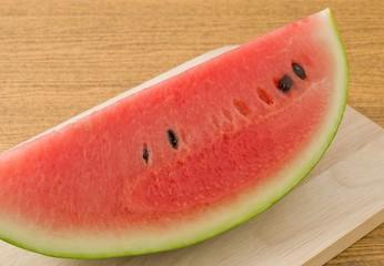Red Ripe Watermelon on A Wooden Board
