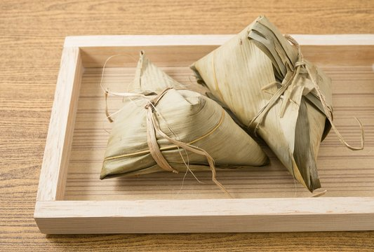 Zongzi or Sticky Rice Dumpling on A Wooden Tray