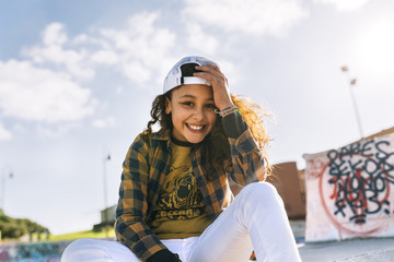 Portrait of smiling girl wearing baseball cap