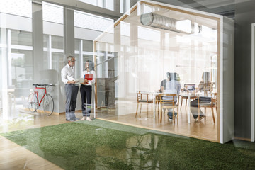 Businessman and woman talking in modern office