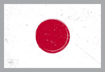 Japan flag with grunge elements on grey background