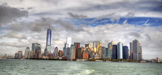 Dramatic colorful HDR image of the skyline of Downtown Manhattan on a cloudy day from the Hudson River, New York City, USA - panoramic image