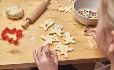 Little girl preparing Christmas cookies