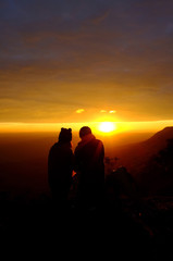 couple looking out into the beautiful sunset.