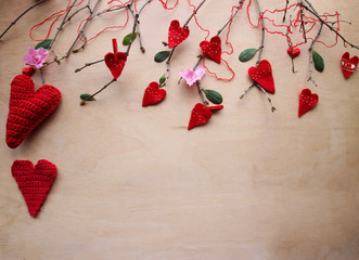 Branch with red hearts.  Showing love through handmade gift