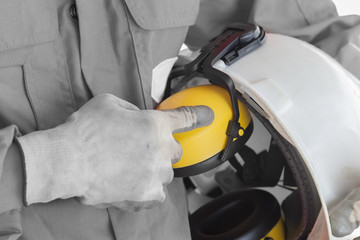Safety concept, Worker showing finger index to safety helmet