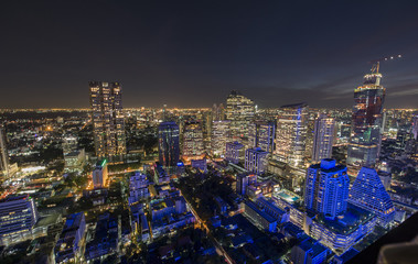 Aerial view de-focused of Bangkok city twilight over Silom road, Image blurred.