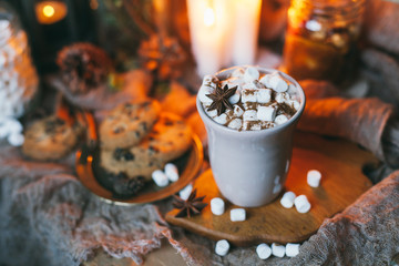 cup of cocoa with marshmallows, candles