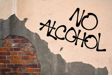 No Alcohol - handwritten graffiti sprayed on the wall - fight against drinking. Abstinence of abstainer - refusal and denial of alcoholic liquid