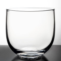 Glass transparent goblet on a light background