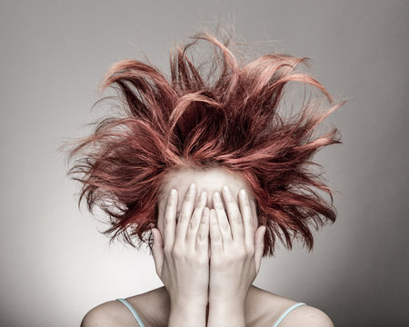Frightened woman with messy hair