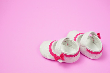 Children's shoes pink background.