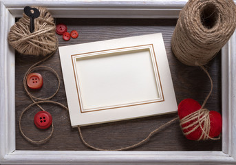 White photo frame on wooden table over  background, Valentine concept