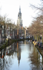 Canal and the tower of New Church in the city of Delft.The Netherlands