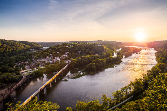 The sun sets over the Potomac River and Harpers Ferry, West Virginia.
