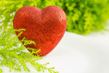 Holiday heart on a green background closeup