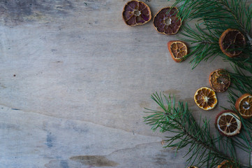 Wooden Christmas background with candied fruits of oranges and n