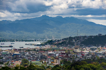 Fotobehang Indonesië Ambon City, Indonesia. Ambon City on Ambon Island boasts excellent transport connections and facilities and make it a gateway to Maluku, and its colonial forts, green hills and pleasant beaches.