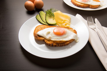 Fried egg with knife and fork