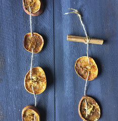 Overhead view of dried citrus fruit garland on table