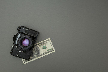 Black camera and one hundred dollars